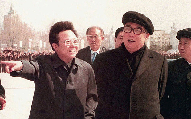 KIM JONG IL KIM IL SUNG...FILE--North Korean leader Kim Jong Il gestures while taking a stroll with his father Kim Il Sung, right, in this April, 1982 file photo in Pyongyang. North Korea's legislature elected party chief Kim Jong Il chairman of the National Defense Commission on Saturday, September 5, 1998, making him the nation's head of state after the legislature abolished the post of president, media reports said. (AP Photo/Kyodo, File)