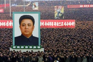 A large portrait of North Korean leader Kim Jong Il looms over tens of thousands of people who packed Pyongyang's main plaza, the Kim Il Sung Square, on Saturday Jan. 11, 2003, to support North Korea's withdrawal from the global nuclear treaty. The rally came a day after North Korea dramatically escalated tentions by announcing its withdrawal from the nuclear treaty. (AP Photo/Xinhua, Gong Yidong)