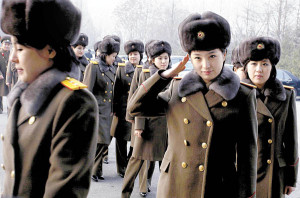Members of the Moranbong Band and the State Merited Chorus of North Korea walk to get on a train at the station in Pyongyang, North Korea, Wednesday, Dec. 9, 2015. They give friendship performances in China. (AP Photo/Kim Kwang Hyon)